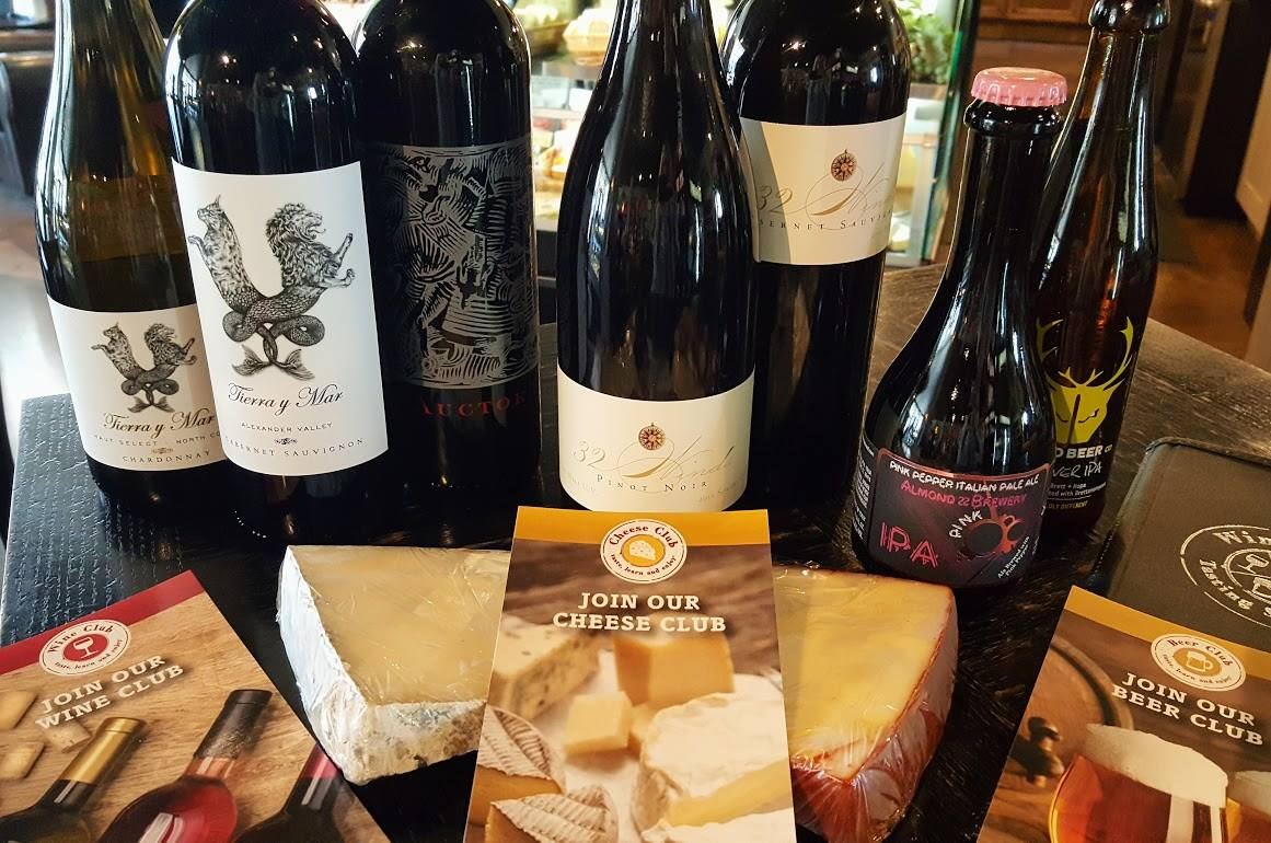 wine cheese and beer with club brochures
