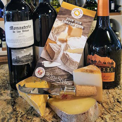 Cheese Club brochure with cheese and wine bottles